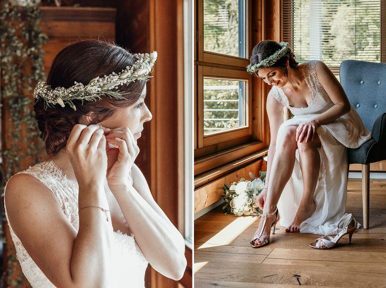 Braut zieht die Brautschuhe und Ohrringe an
